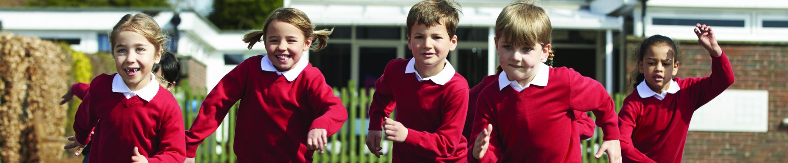 Children running at school Early Years